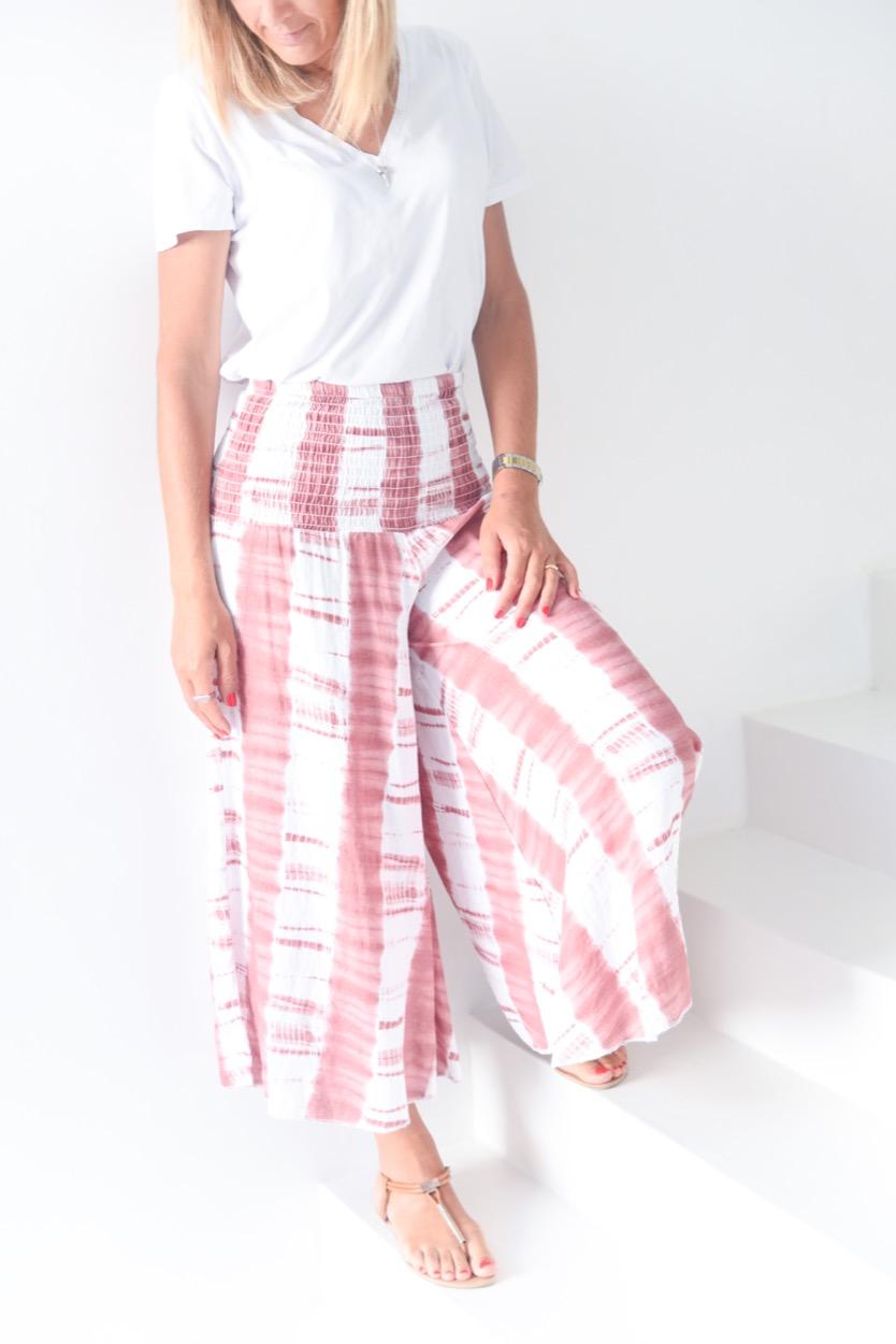 calças rosa manchadas