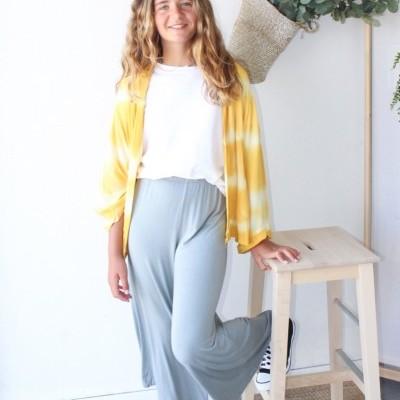 calças midi lisas