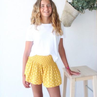 calções amarelos elástico cintura