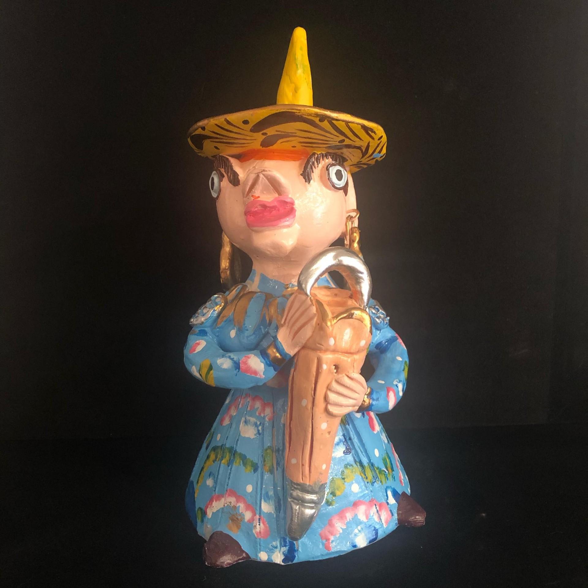 Boneca com chapéu de chuva