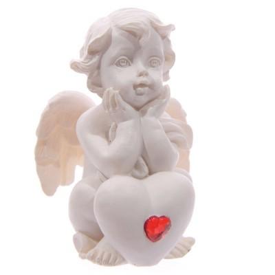 Anjo branco sentado com gema Vermelha