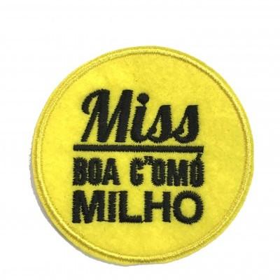 Emblema Miss boa como o milho