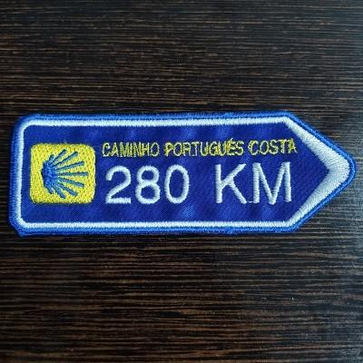 Emblema (Direção Caminho da Costa)