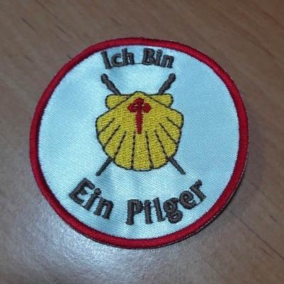 Emblema (Icn Bin Ein Pilger)