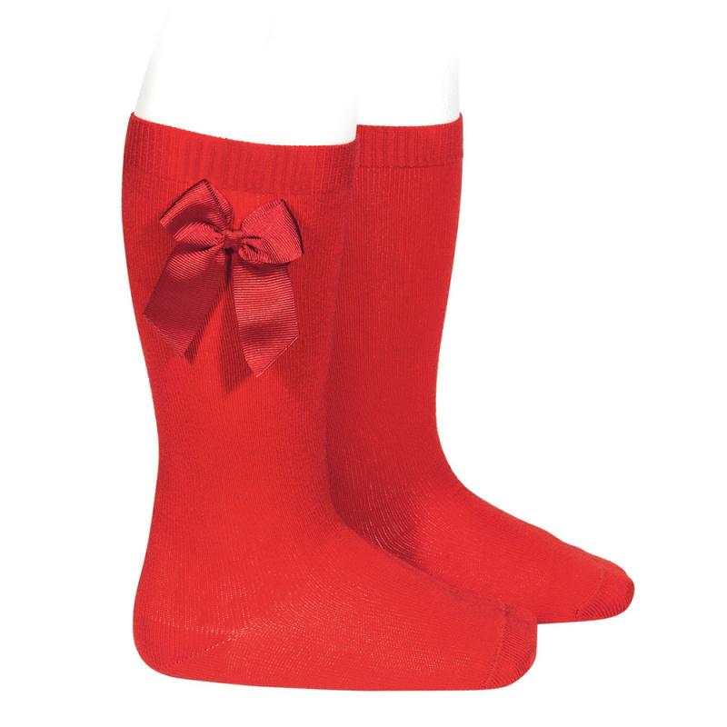 Meia pelo joelho com laço vermelho