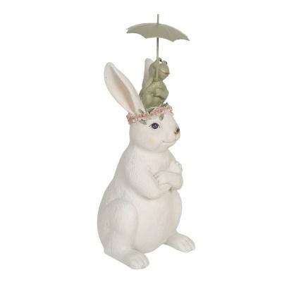 Figura coelho com rã sentada na cabeça e chapeu chuva