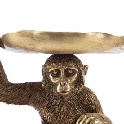 Macaco dourado com folha na cabeça