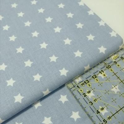 Tecido Estrelas brancas fundo azul céu